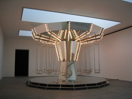 CARSTEN HÖLLER Carousel Mirror, 2005 Mirrors mounted on MDF panels, lightbulbs, stainless steel seats, stainless steel chains, steel construction, electric motor, cables 295 1/4 × 185 × 185 inches (750 × 470 × 470 cm). Installation at Gagosian Gallery Britannia Street, London.