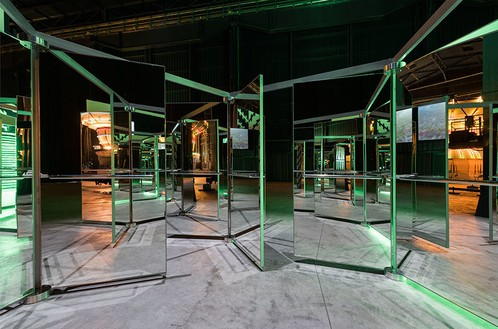 Carsten Höller Revolving Doors, 2016 Mirrored revolving glass doors, aluminum, alucobond, and steel 219 3/4 × 219 3/4 × 89 3/4 inches (558 × 558 × 228 cm) Artwork © Carsten Höller, photo by Attilio Maranzano, courtesy Hayward, HangarBicocca