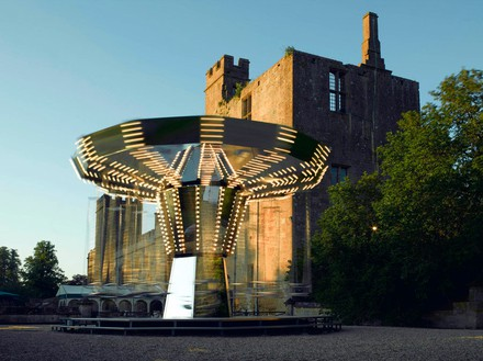CARSTEN HÖLLER Carousel Mirror, 2006 Mirrors mounted on MDF panels, lightbulbs, stainless steel seats, stainless steel chains, steel construction, electric motor, cables 295 1/4 × 185 × 185 inches (750 × 470 × 470 cm) Installation at Sudeley Castle, Winchcombe, UK
