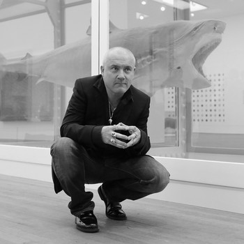 A portrait photograph of Damien Hirst
