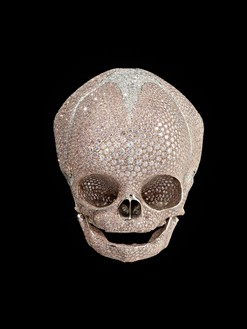 Damien Hirst, For Heaven's Sake, 2008 Platinum and pink diamonds, 3 ⅜ × 3 ⅜ × 3 ⅞ inches (8.5 × 8.5 × 10 cm)© Damien Hirst and Science Ltd. All rights reserved, DACS 2018. Photo: Prudence Cuming Associates