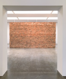 DAN COLEN And She Smiled Sweetly, 2010 Brick wall, concrete, steel 156 × 284 × 100 inches (396.2 × 721.4 × 254 cm) Installation at Gagosian Gallery West 24th Street, New York © Dan Colen *View 1