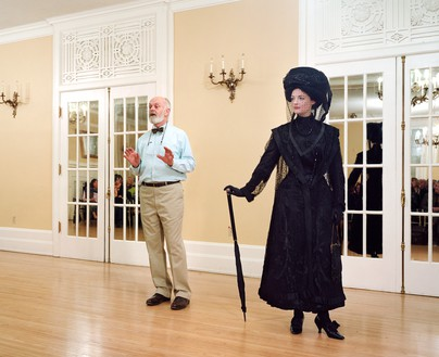 Jeff Wall, Ivan Sayers, costume historian, lectures at the University Women's Club, Vancouver, 7 Dec. 2009. Virginia Newton-Moss wears a British ensemble c. 1910, from Sayers' collection., 2009 Color photograph, 71 ⅞ × 88 ⅜ inches (182.5 × 224.3 cm)© Jeff Wall