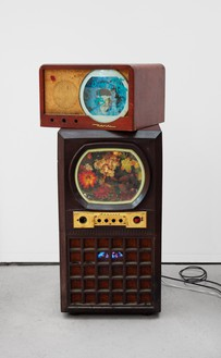 Nam June Paik, Untitled [Cage Composite], 2005 Two-channel video (color, silent) in vintage televisions with electric lights and permanent oil marker, 45 ½ × 21 × 23 ½ inches (115.6 × 53.3 × 59.7 cm)© Nam June Paik Estate