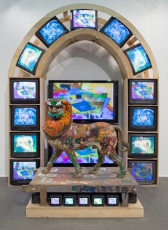 Nam June Paik, Lion, 2005 Three-channel video (color, silent) with 2 plasma monitors and 26 CRT monitors and wood lion with acrylic and permanent oil marker additions, 133 × 109 × 65 inches (337.8 × 276.9 × 165.1 cm)© Nam June Paik Estate