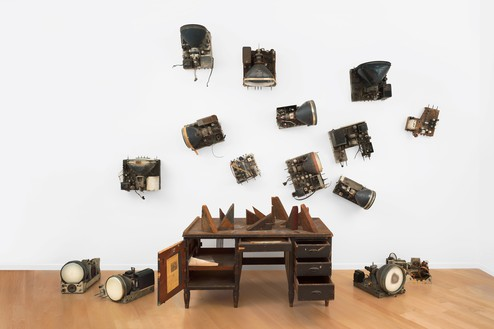 Nam June Paik, 359 Canal Street, 1991 Desk with wood blocks from George Maciunas demolition, acrylic, television chassis, newspaper clippings, piano key, and letters (authors include Yoko Ono, Ray Johnson, and Wolf Vostell), dimensions variable© Nam June Paik Estate