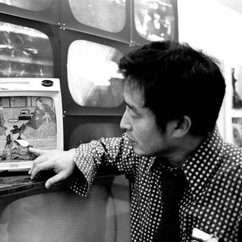 A portrait photograph of Nam June Paik