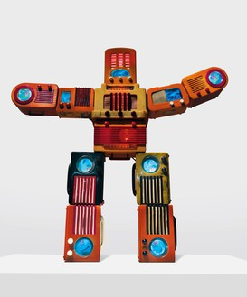 Nam June Paik, Bakelite Robot, 2002 Single-channel video (color, silent) with LCD monitors, colored electric lights, and vintage Bakelite radios, 48 × 50 × 7 ¾ inches (121.9 × 127 × 19.7 cm)© Nam June Paik Estate