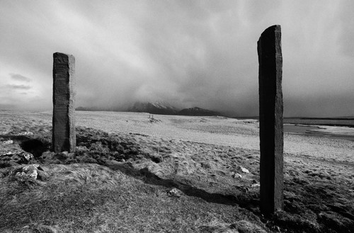 Richard Serra, Afangar (Stations, Stops on the Road, To Stop and Look: Forward and Back, To Take It All In), 1990 Basalt, 18 stones; nine, each: 9 feet 10 inches × 21 ¾ inches × 21 ¾ inches (3 m × 55.2 cm × 55.2 cm); nine, each: 13 feet 1 ½ inches × 21 ¾ inches × 21 ¾ inches (4 m × 55.2 cm × 55.2 cm), permanently installed at Videy Island, Iceland© 2018 Richard Serra/Artists Rights Society (ARS), New York. Photo: Dirk Reinartz