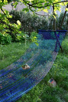Sarah Sze, Landscape of Events Suspended Indefinitely (Hammock), 2015 (detail) Mixed media, including acrylic paint, string, cord, metal, stone, and archival photograph on Tyvek, 115 × 190 × 42 inches (292.1 × 482.6 × 106.7 cm)Installation view, Biennale di Venezia, 2015© Sarah Sze