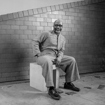 A portrait photograph of Theaster Gates