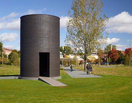 Theaster Gates, Black Vessel for a Saint, 2017 Brick, granite, Cor-Ten steel, concrete, and statue of St. Laurence covered with roofing membrane, 280 × 192 inches (711.2 × 487.7 cm), permanently installed in the Minneapolis Sculpture Garden© Theaster Gates Photo: Gene Pittman, courtesy Walker Art Center, Minneapolis