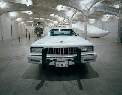 Tom Sachs, Untitled (1989 Chevy Caprice), 2006 Mixed media, 4 feet 8 inches × 17 feet 8 inches × 6 feet 7 inches (1.4 × 5.4 × 2 m)© Tom Sachs. Photo: Attilio Maranzano