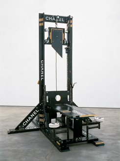 Tom Sachs, Chanel Guillotine (Breakfast Nook), 1998 Wood, steel, leather, nylon, and rubber, 147 × 122 × 125 inches (373.4 × 309.9 × 309.9 cm), Centre Pompidou, Paris© Tom Sachs. Photo: Galerie Thaddaeus Ropac