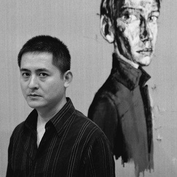 A portrait photograph of Zeng Fanzhi