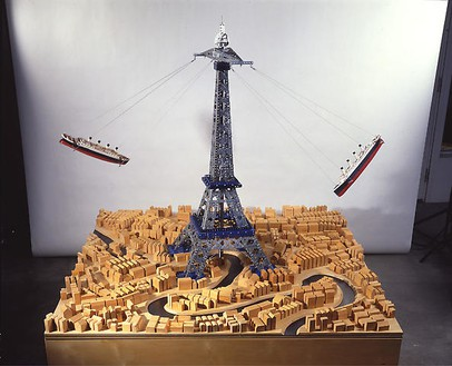 Chris Burden, Another World II, 1993 Wood base, wood block buildings, glass river, 2 Titanic model boats, Meccano building parts, motor, 65 × 59 × 59 inches (165.1 × 149.9 × 149.9 cm)