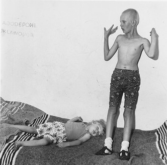 Roger Ballen, Children on Bed, 1996 Selenium toned gelatin silver print, 15 × 15 inches (38.1 × 38.1 cm), edition of 35