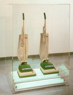 Jeff Koons, New Hoover Convertibles, 1984 Two vacuum cleaners and fluorescent lights in Plexiglas case, 58 × 41 × 28 inches (147.3 × 104.1 × 71.1 cm). Private collection