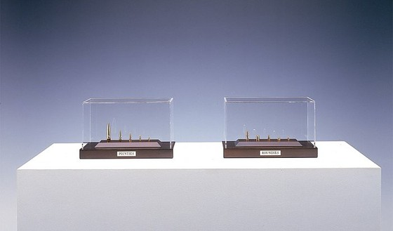 Chris Burden, Gold Bullets, 2003 10 gold bullets in 2 wood and Plexiglas vitrines, each: 6 ¼ × 10 ¼ × 5 ¾ inches (15.9 × 26 × 14.6 cm), edition of 10© Chris Burden/Licensed by The Chris Burden Estate and Artists Rights Society (ARS), New York. Photo: © Douglas M. Parker Studio