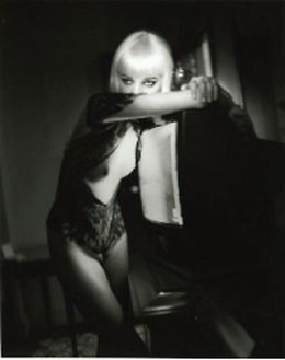 Helmut Newton, Blonde and T.V., Hotel Gallia, Milan, 2002 Silver gelatin print, 63 × 47 ¼ inches (160 × 120 cm), edition of 3