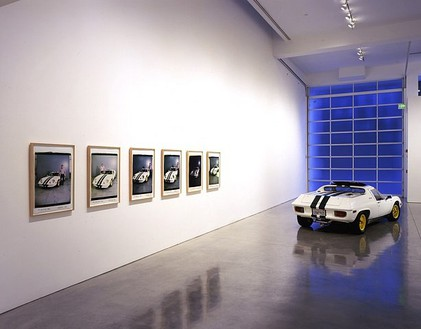 Chris Burden, Lotus, 2006 1973 Lotus Europa and 6 Polaroid prints; car: 42 × 152 × 64 inches (106.7 × 386.1 × 162.6 cm); each print: 24 × 20 inches (61 × 50.8 cm)© Chris Burden/Licensed by The Chris Burden Estate and Artists Rights Society (ARS), New York. Photo: © Douglas M. Parker Studio