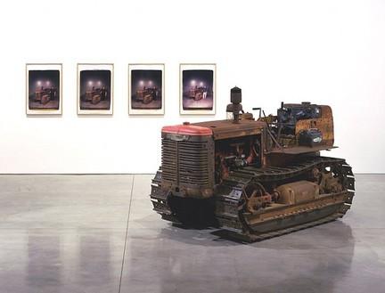 Chris Burden, Bulldozer, 2007 1954 International T6 crawler and 4 Polaroid prints; crawler: 65 × 112 × 54 inches (165.1 × 384.5 × 137.2 cm); each print: 24 × 20 inches (61 × 50.8 cm)© Chris Burden/Licensed by The Chris Burden Estate and Artists Rights Society (ARS), New York. Photo: © Douglas M. Parker Studio