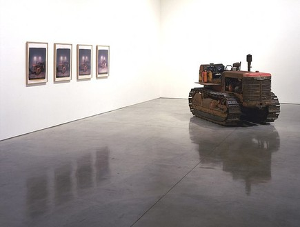 Chris Burden, Bulldozer, 2007 1954 International T6 crawler and 4 Polaroid prints; crawler: 65 × 112 × 54 inches (165.1 × 384.5 × 137.2 cm); each print: 24 × 20 inches (61 × 50.8 cm)© Chris Burden/Licensed by The Chris Burden Estate and Artists Rights Society (ARS), New York. Photo: © Douglas M. Parker Studio