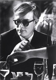 Dennis Hopper, Andy Warhol (at table), 1963 Gelatin silver print, 24 × 16 inches (61 × 40.6 cm)