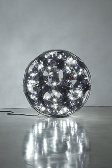 Carsten Höller, Black Double Sphere, 2008 Acrylic glass, bearing, 90 light bulbs, sockets, DMX controller, cables, Diameter: 86 ½ inches (220 cm)Photo by Joshua White