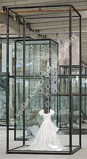 Anselm Kiefer, Die Schechina, 2010 Painted resin dress, glass shards, steel, numbered glass disks, and wire, in inscribed glass and steel vitrine, 179 ⅛ × 82 ¾ × 82 ¾ inches (455 × 210 × 210 cm)© Anselm Kiefer