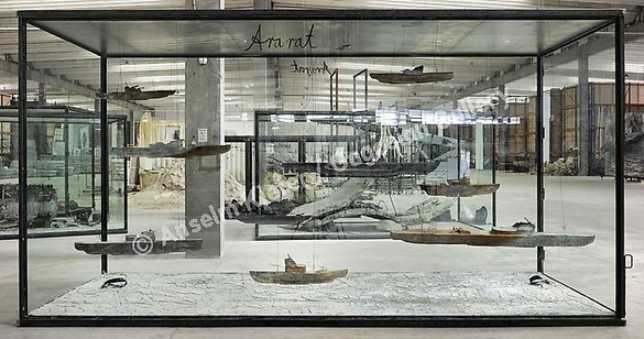 Anselm Kiefer, Ararat, 2010 9 lead boats, wire, and oil, emulsion, acrylic, shellac, and clay on canvas, in inscribed glass and steel vitrine, 114 ⅛ × 216 ½ × 90 ⅝ inches (290 × 550 × 230 cm)© Anselm Kiefer