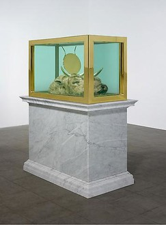 Damien Hirst, End of an Era, 2009 Bull's head, gold, gold-plated steel, glass, and formaldehyde solution, with Carrara marble plinth, 84 × 67 ⅜ × 38 ¼ inches (213.4 × 171 × 97.2 cm)© Damien Hirst and Science Ltd. All rights reserved, DACS 2010