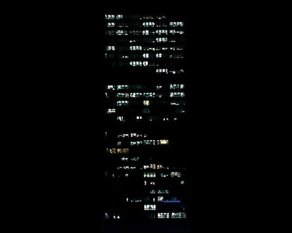Elisa Sighicelli, Phi Building, 2009 (view 1) Video projection, 2:23 loop, color, sound, Dimensions variable, edition of 3
