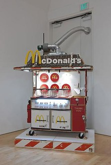 Tom Sachs, Salt the Fries, 2005–09 Plywood, synthetic polymer, hardware, wires, friers, lighting system, fridges, casters, plexiglass, steel, and wood barriers, 100 × 70 × 48 inches (254 × 177.8 × 121.9 cm)Photo: Josh White