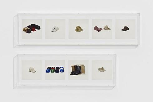 Taryn Simon, HATS (COUNTERFEIT), 2010 9 archival inkjet prints in 2 Plexiglas boxes, Box 1: 9 ¼ × 37 ¼ × 2 ½ inches (23.5 × 94.6 × 6.4cm); Box 2: 9 ¼ × 30 × 2 ½ inches (23.5 × 76.2 × 6.4cm), edition of 4Photo by Douglas M. Parker Studio