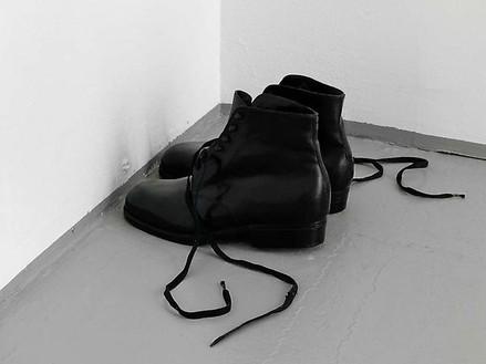 Tatiana Trouvé, Untitled (Men's shoes), 2009 Black patinated bronze, laces, 6 ⅛ × 4 × 11 ⅞ inches (15.6 × 10 × 30 cm)