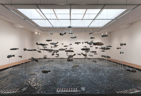 Bruce Nauman, One Hundred Fish Fountain, 2005 Ninety-seven bronze fish of seven different forms, suspended with stainless steel wire from a metal grid, Installation: 300 × 336 inches (762 × 853.4 cm)