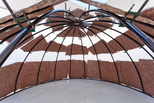 Mario Merz, Igloo, 2002 (view 2) Metal tubular, clips, and irregular stone fragments, 70 ⅞ × 196 ⅞ × 196 ⅞ inches (180 × 500 × 500 cm)© 2013/Artists Rights Society (ARS), New York / SIAE, Rome, photo by Zarko Vijatovic