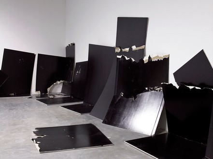 Steven Parrino, 13 Shattered Panels (for Joey Ramone), 2001 13 standard panels of gypsum plaster board painted with black industrial lacquer, Dimensions variable
