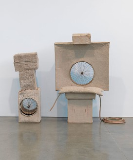 Robert Rauschenberg, Untitled (Early Egyptian), 1974 Cardboard, sand, Day-Glo paint, spoked wheels, pillow, and hose, 80 ¼ × 78 × 36 inches (203.8 × 198.1 × 91.4 cm)© The Robert Rauschenberg Foundation 2014/Licensed by VAGA, New York. Photo: Rob McKeever