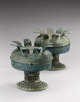 Archaic vessels with petalled covers (dou), early Spring and Autumn period (770–481 BCE) Bronze, set of 2; each, height: 9 ⅞ inches (25 cm)Inscriptions inside each vessel and coverPhoto: Frédéric Dehaen, Studio Roger Asselberghs