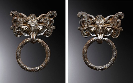 Masks and rings, early Western Han dynasty (206 BCE–9 CE) Iron inlaid with gold and silver, set of 2; each, height: 12 ¼ inches (31 cm)Photo: Frédéric Dehaen, Studio Roger Asselberghs