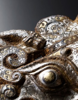 Masks and rings, early Western Han dynasty (206 BCE–9 CE) (detail) Iron inlaid with gold and silver, set of 2; each, height: 12 ¼ inches (31 cm)Photo: Frédéric Dehaen, Studio Roger Asselberghs