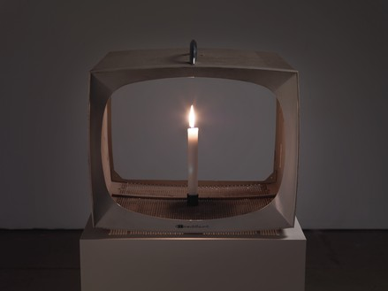 Nam June Paik, Candle TV, 1991–2003 Vintage metal television housing with permanent oil marker and lit candle, 15 × 16 ⅜ × 14 ⅞ inches (38.1 × 41.6 × 37.8 cm)© Nam June Paik Estate