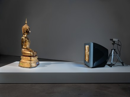 Nam June Paik, Golden Buddha, 2005 Closed-circuit video (color) with television and wood Buddha with permanent oil marker, 46 ½ × 106 × 31 ¾ inches (118.1 × 269.2 × 80.6 cm)© Nam June Paik Estate