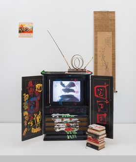 Nam June Paik, Chinese Memory, 2005 Single-channel video (color, silent) in vintage television cabinet with permanent oil marker, acrylic, record cover, scroll, antennae, and books, 81 × 55 × 44 inches (205.7 × 139.7 × 111.8 cm)© Nam June Paik Estate