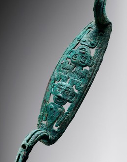 Bow-shaped fitting, Shang dynasty (1600–1050 BCE)—13th to 11th century BCE Bronze, length: 14 ¼ inches (36 cm)Photo: Frédéric Dehaen, Studio Roger Asselberghs