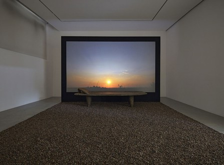 Romuald Hazoumè, Antidépresseur, 2013 Sénoufo bed, cocoa beans, and video, 102 ⅜ × 155 ⅞ × 162 3/16 inches (260 × 396 × 412 cm)© Romuald Hazoumè, ADAGP 2016, photo by Thomas Lannes