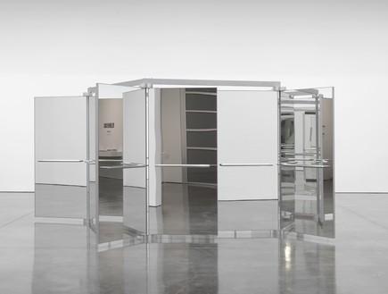 Carsten Höller, Revolving Doors, 2004–16 Five mirrored three-winged revolving glass doors, aluminum, and polypropylene panels, 219 ⅝ × 219 ⅝ × 89 ¾ inches (558 × 558 × 228 cm)© Carsten Höller. Photo: Rob McKeever