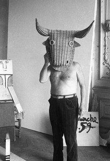 Picasso wearing a bull's head intended for bullfighter's training, La Californie, Cannes, 1959 Photo: Edward Quinn, © edwardquinn.com